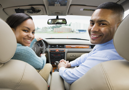 Auto Plus Insurance Group LLC | A father teaching his daughter how to drive a car