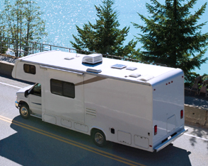 Auto Plus Insurance Group LLC | RV traveling down an interstate near a body of water with trees on a sunny day